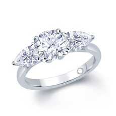 Platinum 0.80ct 3 Stone Brilliant Cut & Pear Shape Diamond Claw Set Trilogy Ring